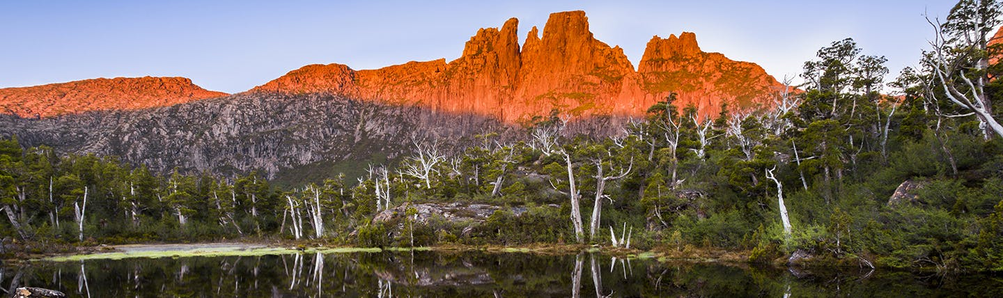 Orange mountain with lake and trees in Tasmania