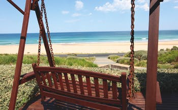 Chocolate Gannets Victoria and Melbourne exterior wooden love seat swing overlooking beach
