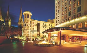 Park Hyatt Melbourne exterior, a lagre white building with entrance porch and fountain