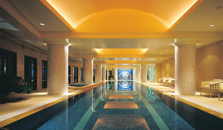 Park Hyatt Melbourne indoor swimming pool with columns and loungers