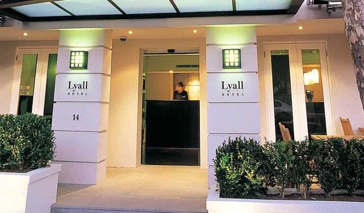 The Lyall Hotel Melbourne exterior white building entrance with signs reading 'The Lyall Hotel'