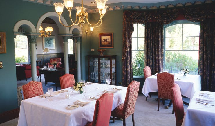 Woodman Estate Victoria formal dining room with arches chandeliers and draped curtains