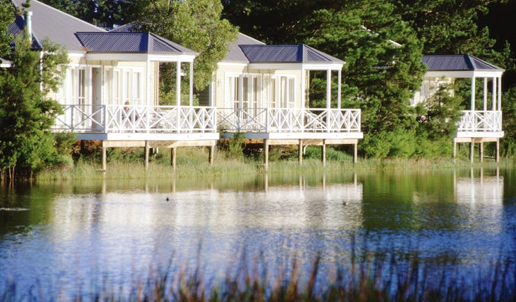 Woodman Estate Victoria lakeside chalets three white wooden chalets with balconies overlooking a lake