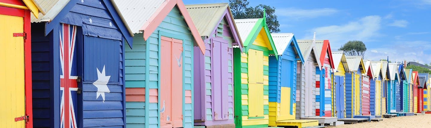 Multi coloured beach huts in a row on Brighton Beach Melbourne