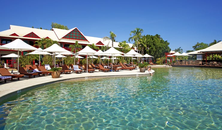 Cable Beach Club pool, sun loungers and umbrellas