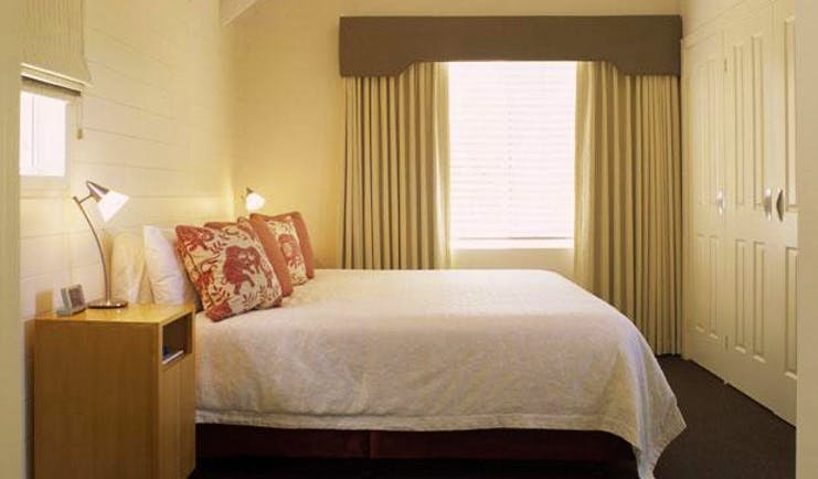 Cape Lodge Western Australia bedroom with bedside tables and wardrobe