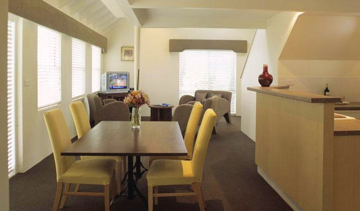 Cape Lodge Western Australia living room with sofa and dining table