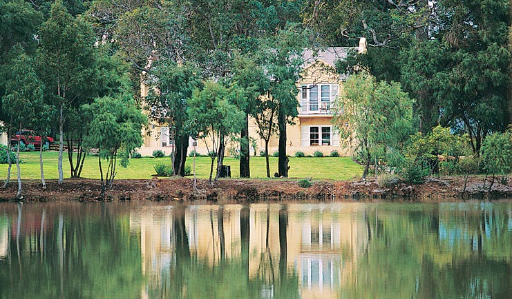 Cape Lodge Western Australia terrace suites view yellow building overlooking trees and a creek