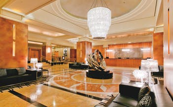 Duxton Hotel Western Australia and Perth lobby area with glass chandelier marble floor and metal sculpture