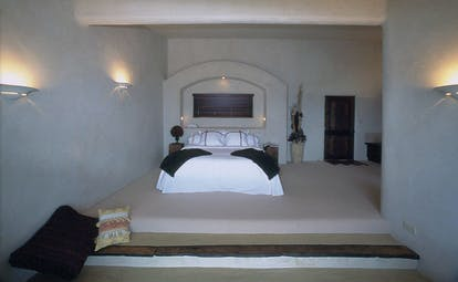 Bedroom with double bed, lights on the walls and television