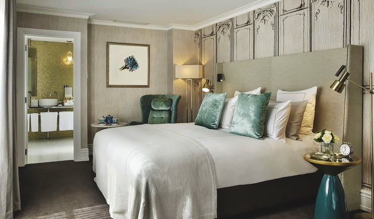 Hotel Grand Windsor Auckland superior king bedroom with armchair and view to bathroom