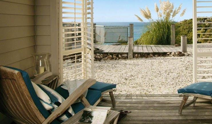 The Boatshed Waiheke Island Auckland beach terrace with loungers