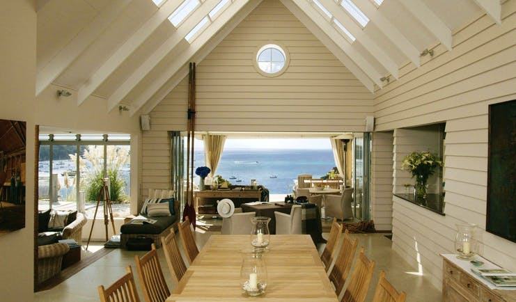 The Boatshed Waiheke Island Auckland dining room with patio and  beach access