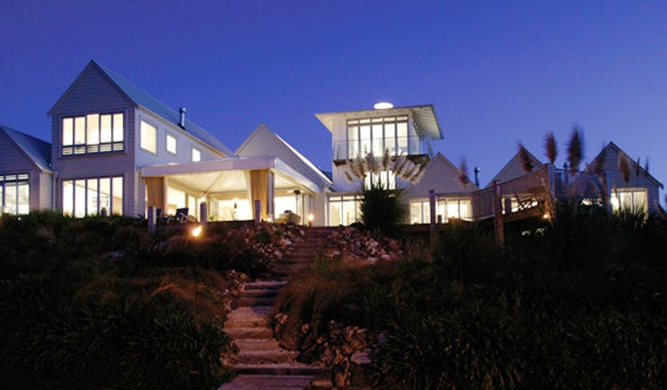 The Boatshed Waiheke Island Auckland exterior night white building with large windows at night