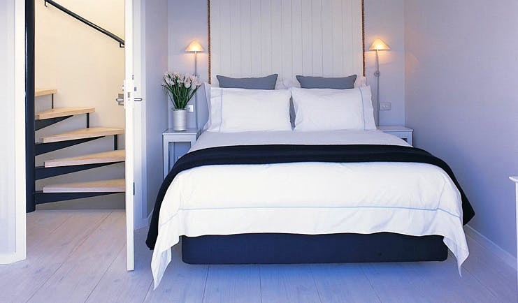 The Boatshed Waiheke Island Auckland lighthouse bedroom with spiral staircase