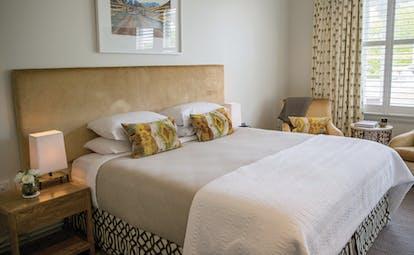 Marlborough Lodge Blenheim and Marlborough bedroom with two armchairs