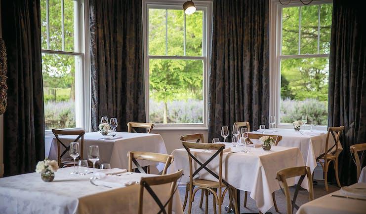 Marlborough Lodge Blenheim and Marlborough dining area with windows to gardens