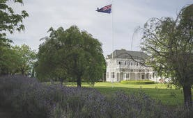 Marlborough Lodge Blenheim and Marlborough exterior white building with covered porch trees and lavender bushes