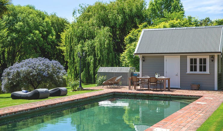 Marlborough Lodge Blenheim and Marlborough pool in garden with trees and lavender