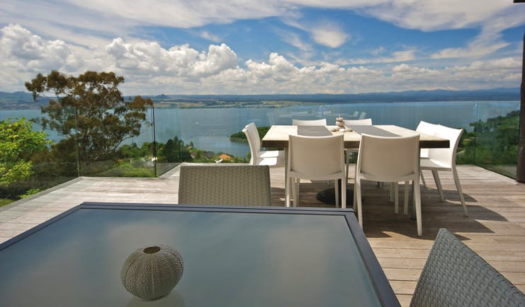 Acacia Cliffs Lodge Central North Island deck seating area with coast view