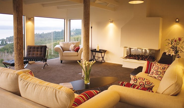Acacia Cliffs Lodge Central North Island lounge with large windows and coast view