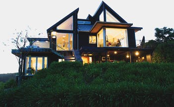 Acacia Cliffs Lodge Central North Island outside modern building with large lit up windows