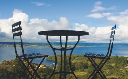 Acacia Cliffs Lodge Central North Island panorama table and two chairs overlooking the coast