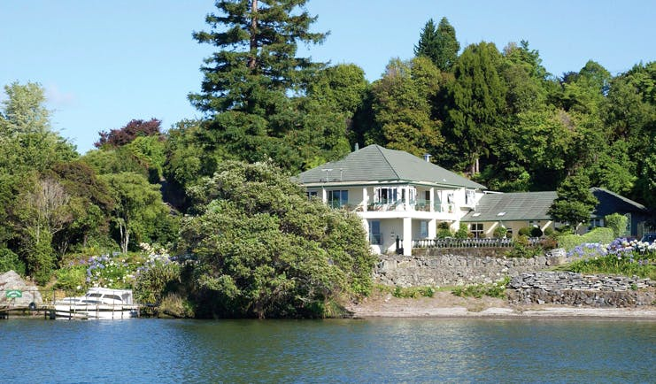 Black Swan Boutique Hotel Central North Island aerial white lodge surrounded by trees overlooking the sea