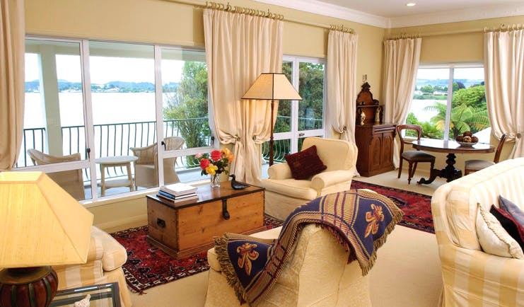 Black Swan Boutique Hotel Central North Island lounge area with armchairs and balcony with sea view