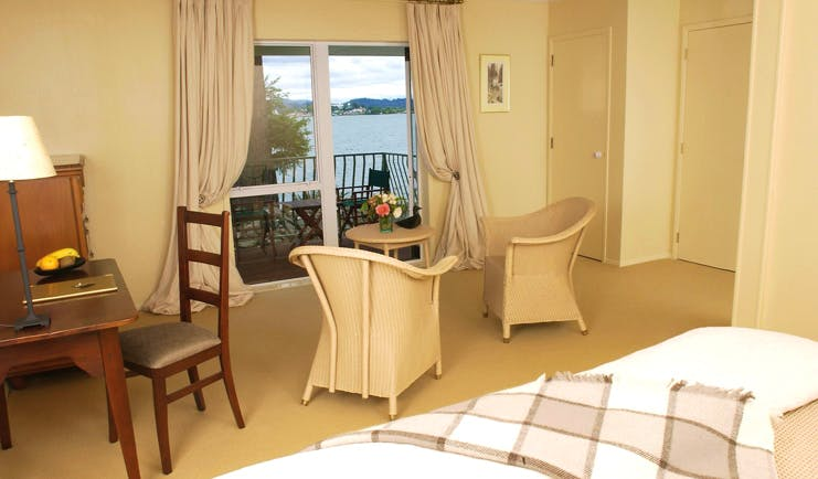 Black Swan Boutique Hotel Central North Island suite with sitting area and balcony with sea view