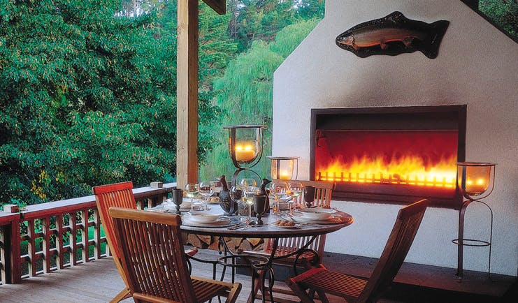Huka Lodge Central North Island dining outdoor decked dining area with fireplace
