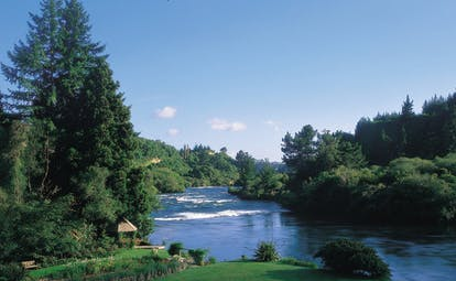 Huka Lodge Central North Island river aerial view of river with wooded banks