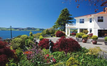 Peppers on the Point Central North Island courtyard white building with gardens and lake view