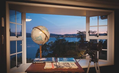 Peppers on the Point Central North Island viewpoint globe and telescope in a window with lake view