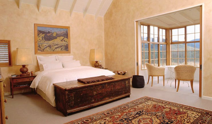 Poronui Ranch Central North Island bedroom with large bay window with seats