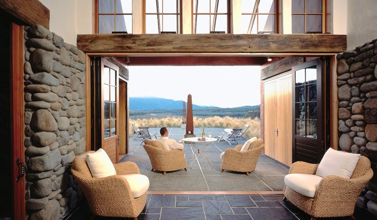 Poronui Ranch Central North Island lounge with stone walls and terrace