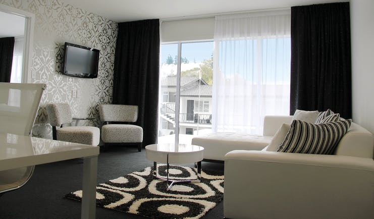 Regent of Rotorua Central North Island lounge with black and white patterned walls and large windows