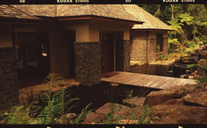 Treetops Lodge Central North Island bridge to access lodge building with stone columns