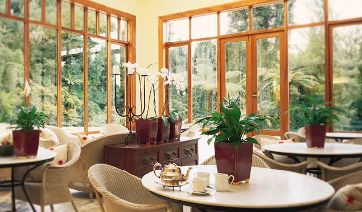 Treetops Lodge Central North Island conservatory dining area
