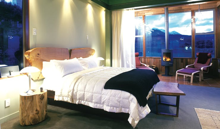 Hapuku Lodge Central South Island bedroom with fireplace and mountain view