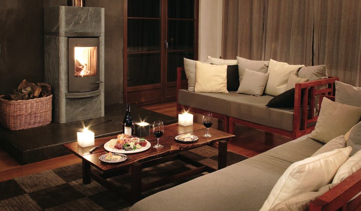 Hapuku Lodge Central South Island lounge area with sofas and fireplace
