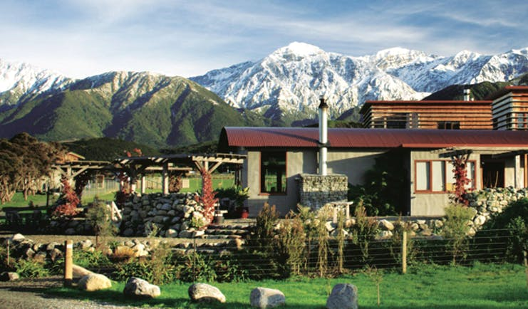 Hapuku Lodge Central South Island mountains wooden lodge with garden and mountain view