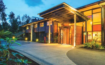 Te Waonui Forest Retreat Central South Island exterior building with large windows and wood facade