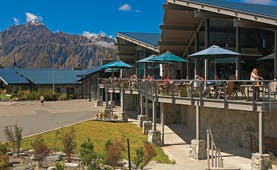 The Hermitage Hotel Central South Island cafe outdoor dining area with umbrellas and mountain view