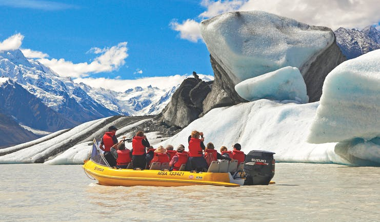 The Hermitage Hotel Central South Island glacier tour people in small boat looking at glacier