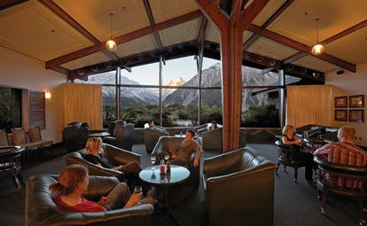 The Hermitage Hotel Central South Island lounge with leather seats with panoramic mountain view