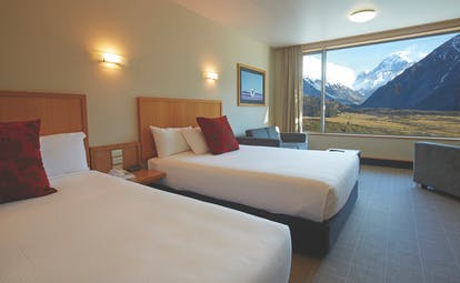 The Hermitage Hotel Central South Island twin bedroom with large window and mountain view