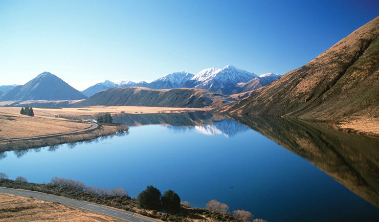 Wilderness Lodge at Nelsons Pass Central South Island lake surrounded by snow capped mountains
