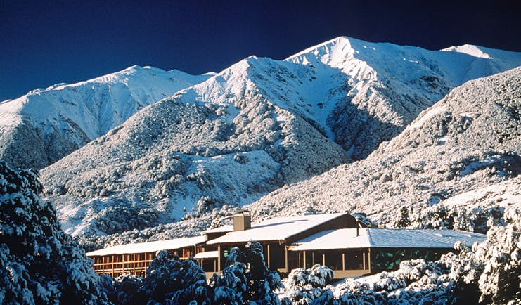 Wilderness Lodge at Nelsons Pass Central South Island mountain lodge overlooked by snowy mountain
