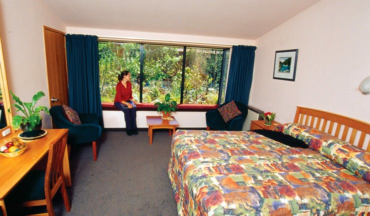 Wilderness Lodge at Nelsons Pass Central South Island room woman sat on windowsill in bedroom